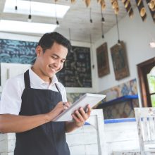Portrait,Of,Asian,Young,Male,Cafe,Owner,With,Tablet