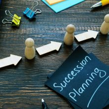 Succession,Planning,Sign,And,Figurines,With,Arrows.