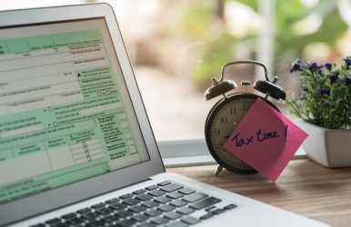 Tax,Time,Post-it,On,Alarm,Clock,And,Individual,Income,Tax